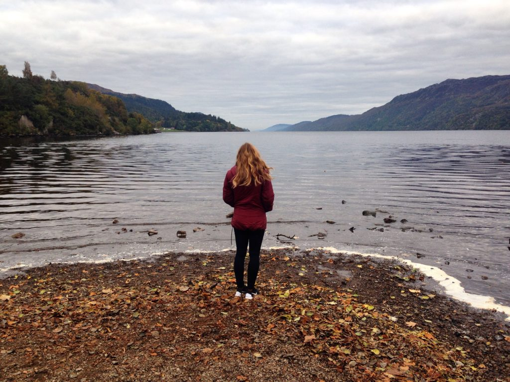 Standing looking at a loch in Scotland