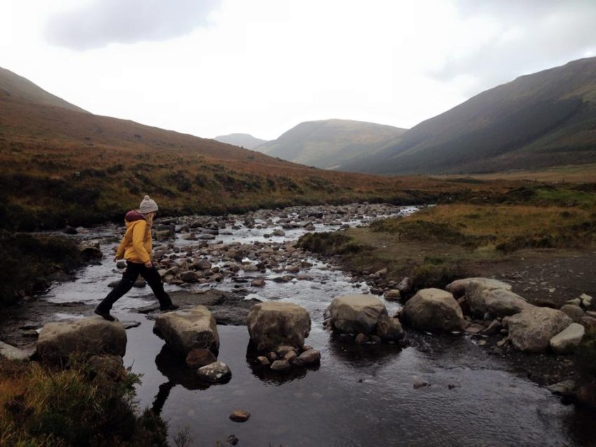 walking on some stepping stones in Scotland