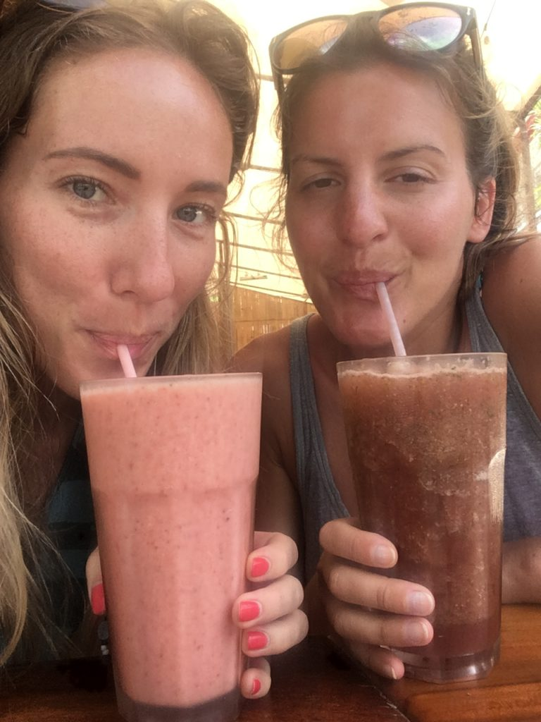 Drinking smoothies with friends in costa rica, girls drinking smoothies on holiday
