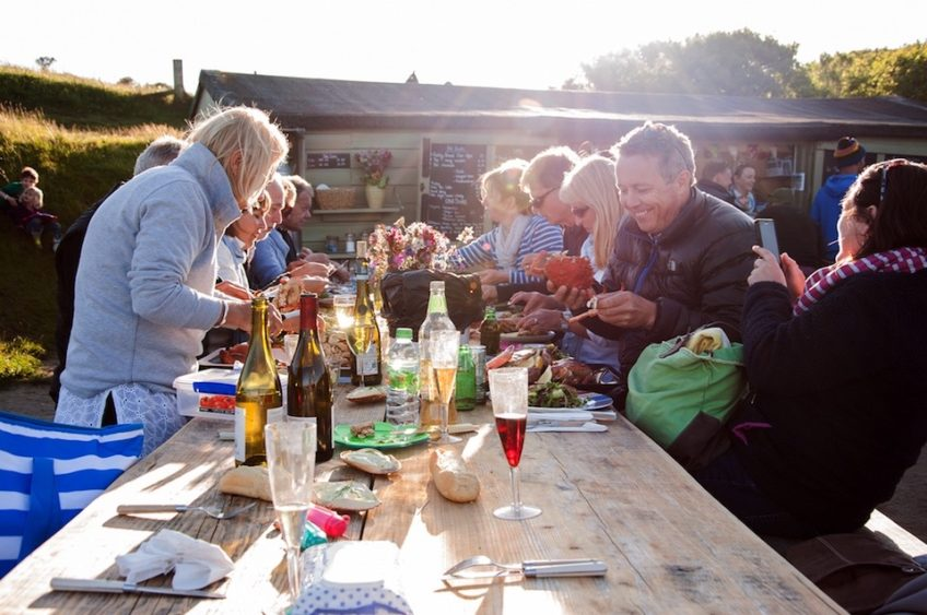 People eating dinner at the hidden hut in Cornwall's roseland peninsula in summer 2017 what's on in Cornwall guide to cornwall