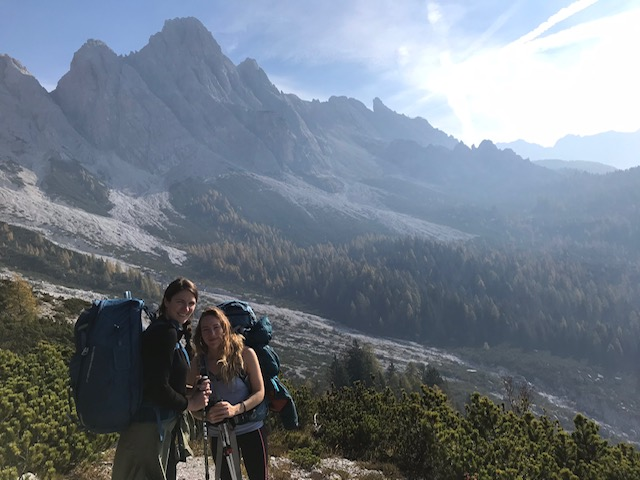 Hiking in the Dolomites, two women in October on a sunny day